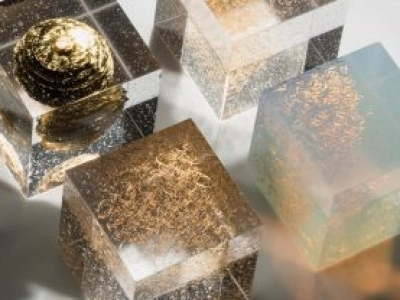 Kiln formed layered glass with gold enamel